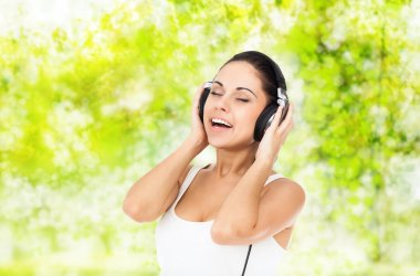 Woman in headphones listens to music