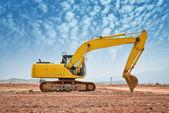 Fotografie excavator loader machine during earthmoving works outdoors