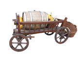 Vintage wooden cart with wine barrel, basket and pumpkin isolate