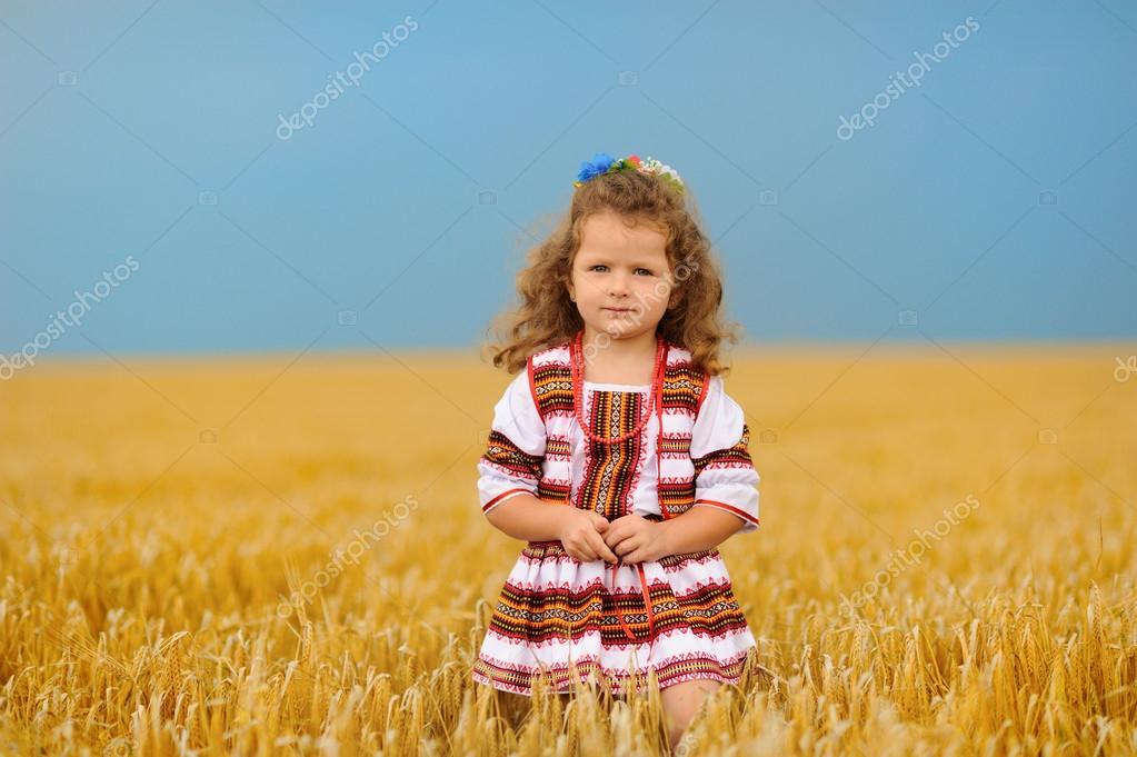 Cute little girl on wheat field