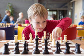Photo Young chess player at a tournament