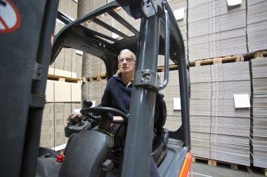 Forklift driver inside forklif