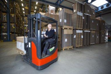 Truck driving around warehouse