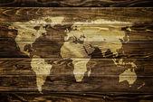 Weltkarte auf Holz-Hintergrund