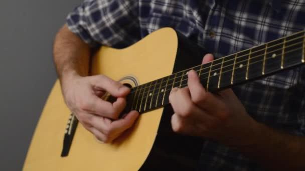 Man playing acoustic guitar,