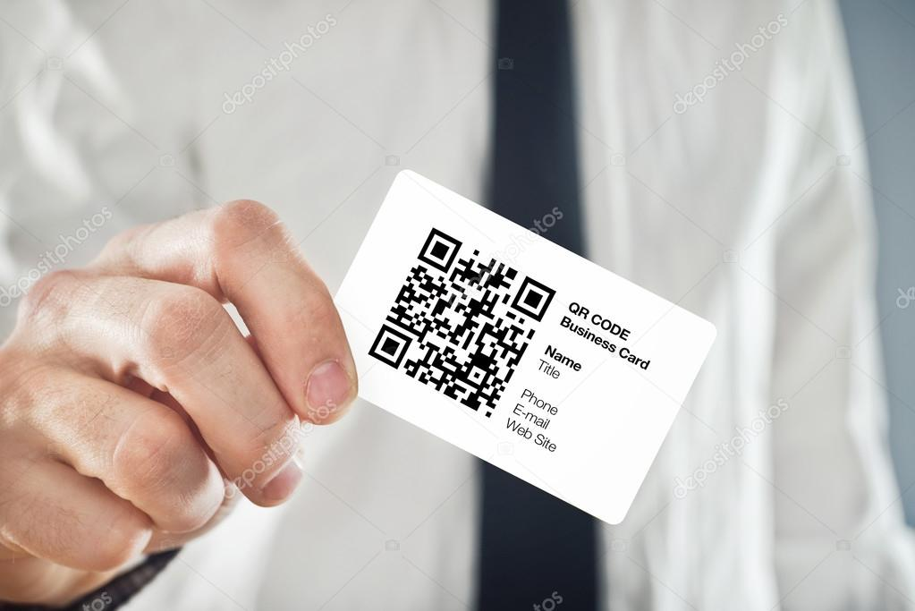 Businessman holding QR code business card — Stock Photo ...