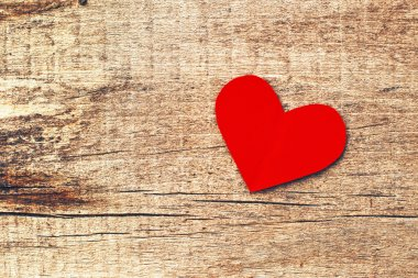 Paper heart on wood background