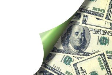 Hundred dollar bills behind curld page