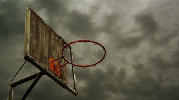Obsolete Basketball hoop with cage with clouds time lapse footage in background. 1920x1080, 1080p, hd footage.