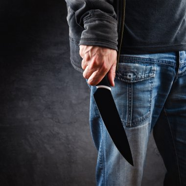 Evil man hold shiny knife, killer in action