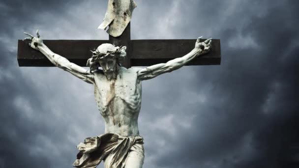 Crucifixion. Christian cross with crucified Jesus Christ statue over dark clouds time lapse. 1920x1080 full hd format.