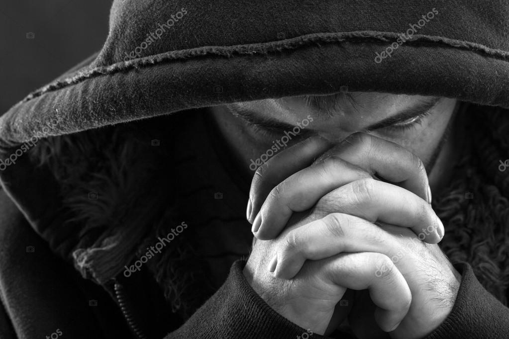 Despair bandit praying God for forgiveness stock vector