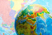 Globe against map