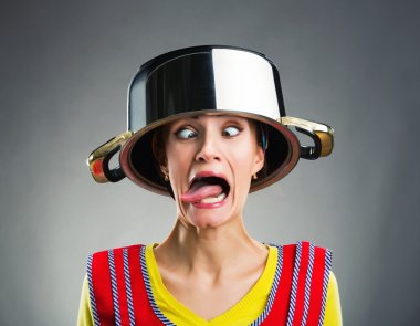 Crazy housewife with sause pan on her head