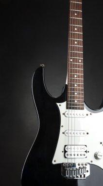 Closeup of black modern electric guitar