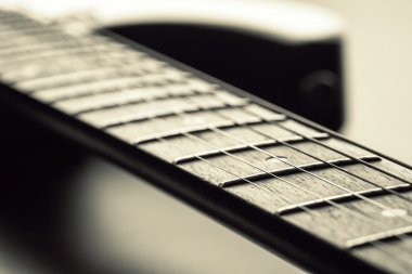 Closeup of electric guitar fretboard