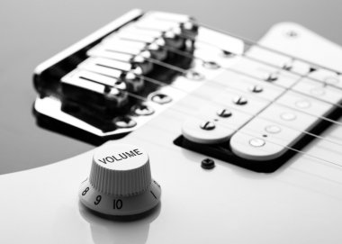 Strings and Volume knob on electric guitar