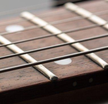 Macro of strings on electric guitar