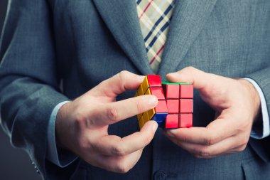 Businessman holding rubik cube