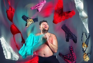 Man looking at flying womans underwear