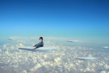 Businessman flying on paper plane