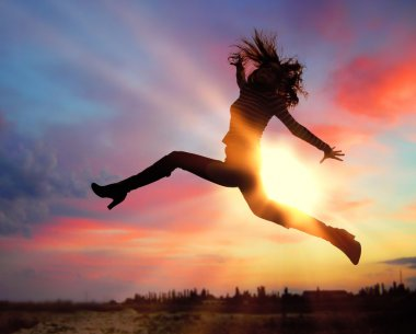 Silhouette of jumping girl