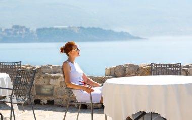 Woman on sea terrace