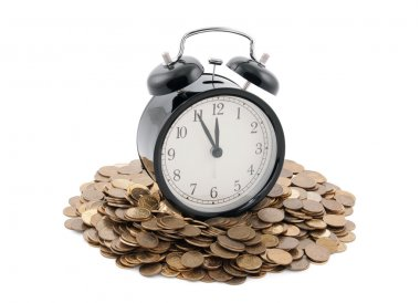 Time is money. Alarm clock with coins. Clipping path included.