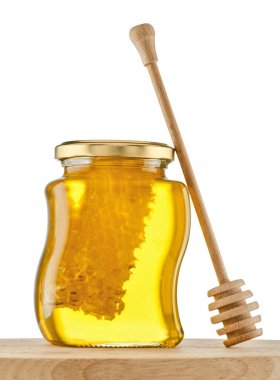 Glass of gold honey with honeycomb , dipper, isolated white background , clipping path stock vector