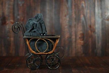 Baby Cradle on Grunge Wooden Background