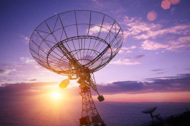 satellite dishes with sunset