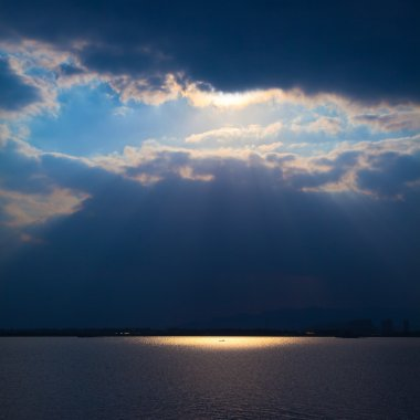Through clouds on the river light flows