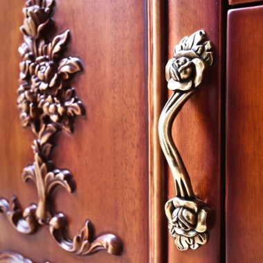detail of decorated furniture drawers