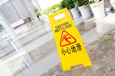 Sign showing warning of caution wet floor
