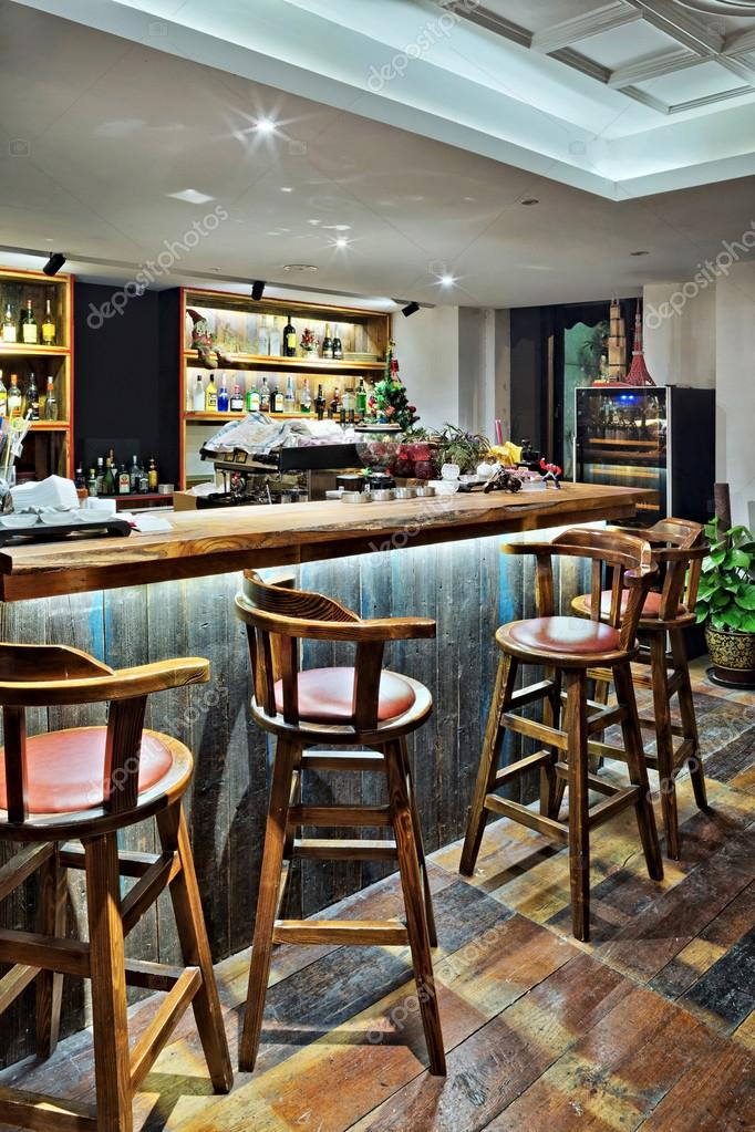bar counter with chairs in empty comfortable restaurant