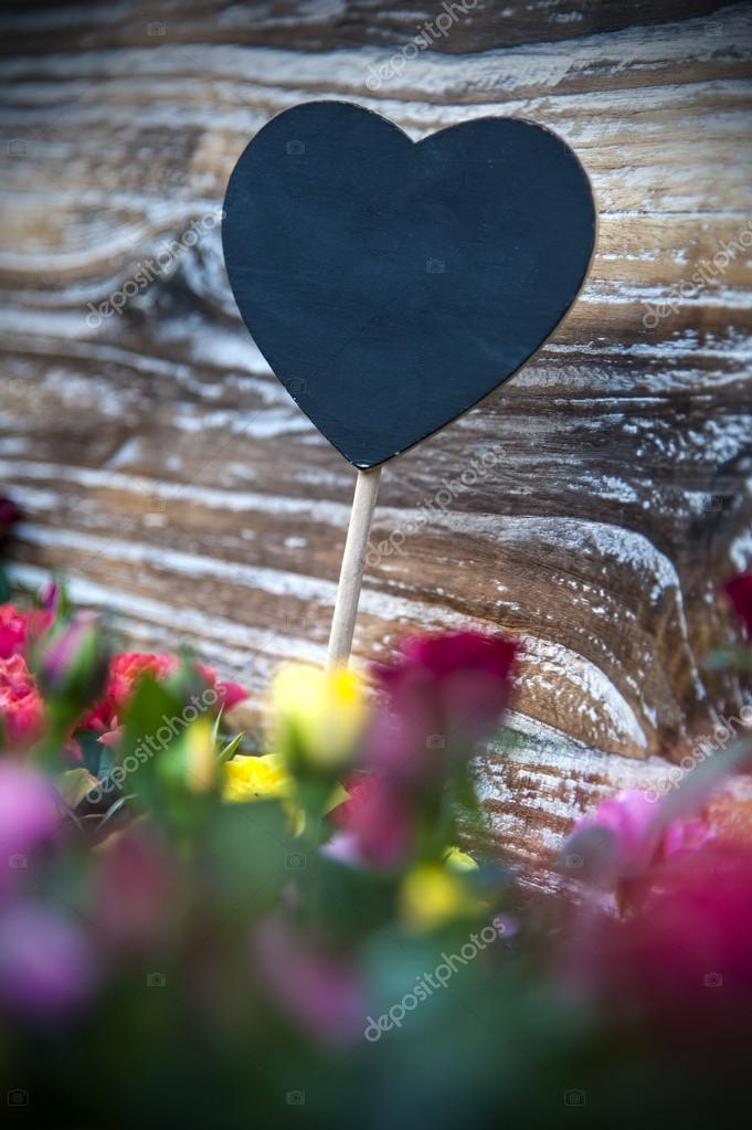 Flowers with heart label