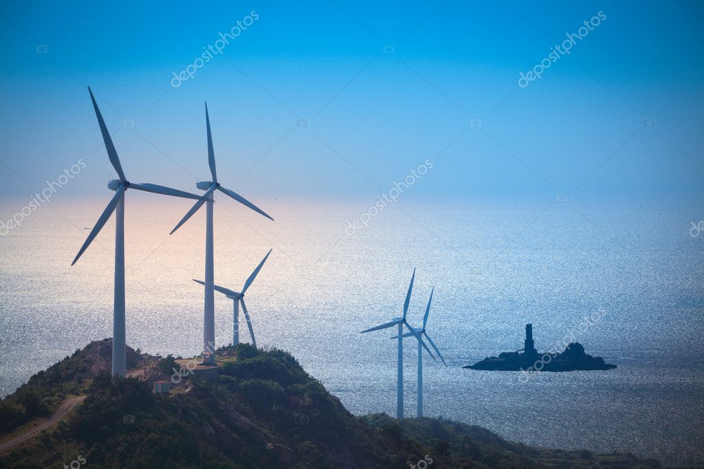 Wind turbines generating electricity at the beach