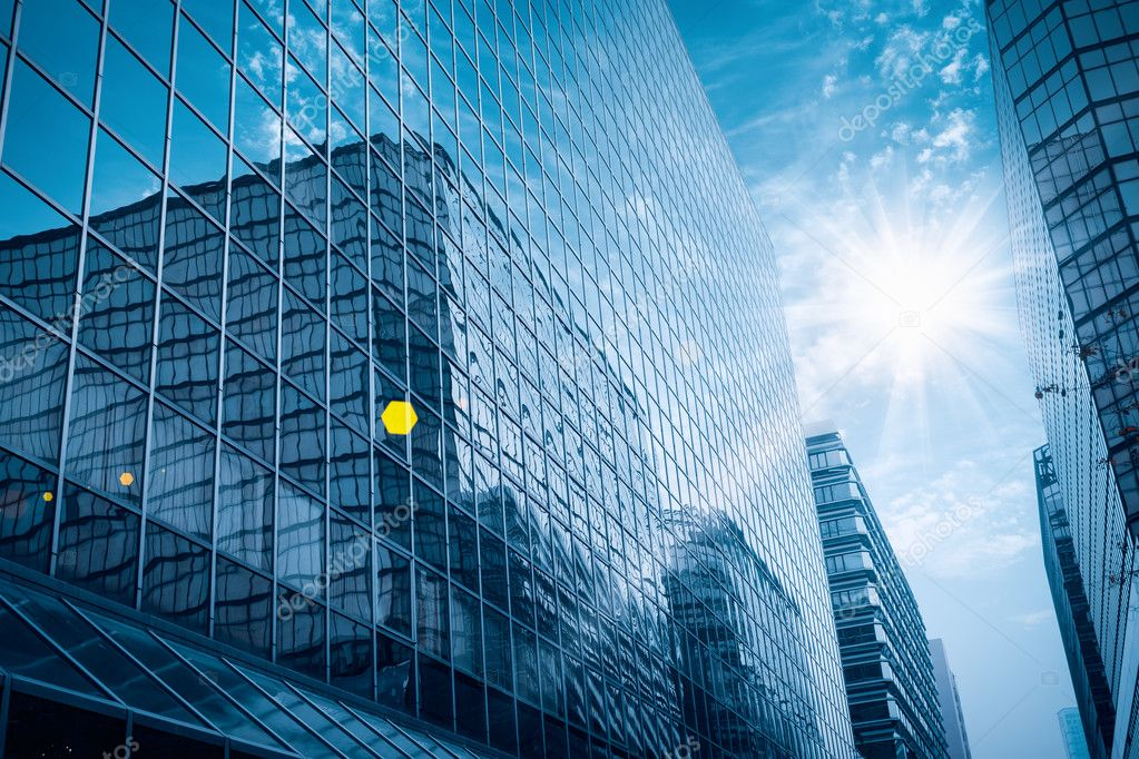 modern glass building under the blue sky