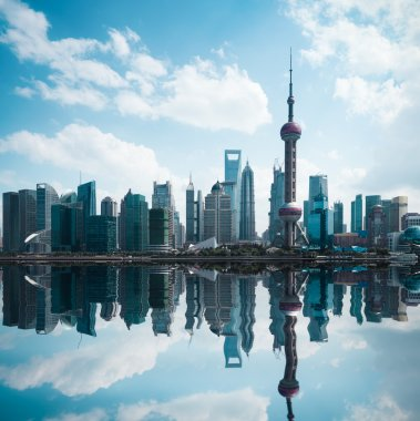 cityscape of modern city with reflection in shanghai