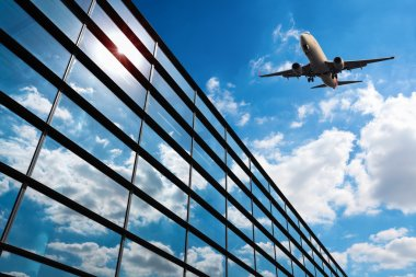 Glass curtain wall and aircraft against a blue sky stock vector