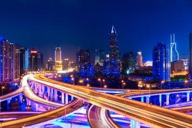 modern city skyline with interchange overpass at night