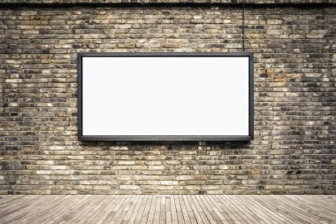 blank billboard on old brick wall