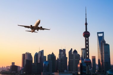 modern city skyline with airplane
