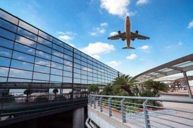 modern airport terminal and aircraft