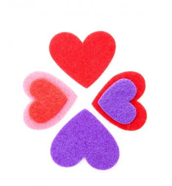 Four hearts made of felt over white background stock vector
