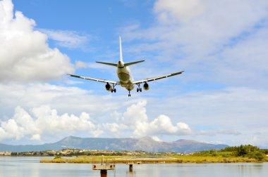 Passenger airplane landing to active runway