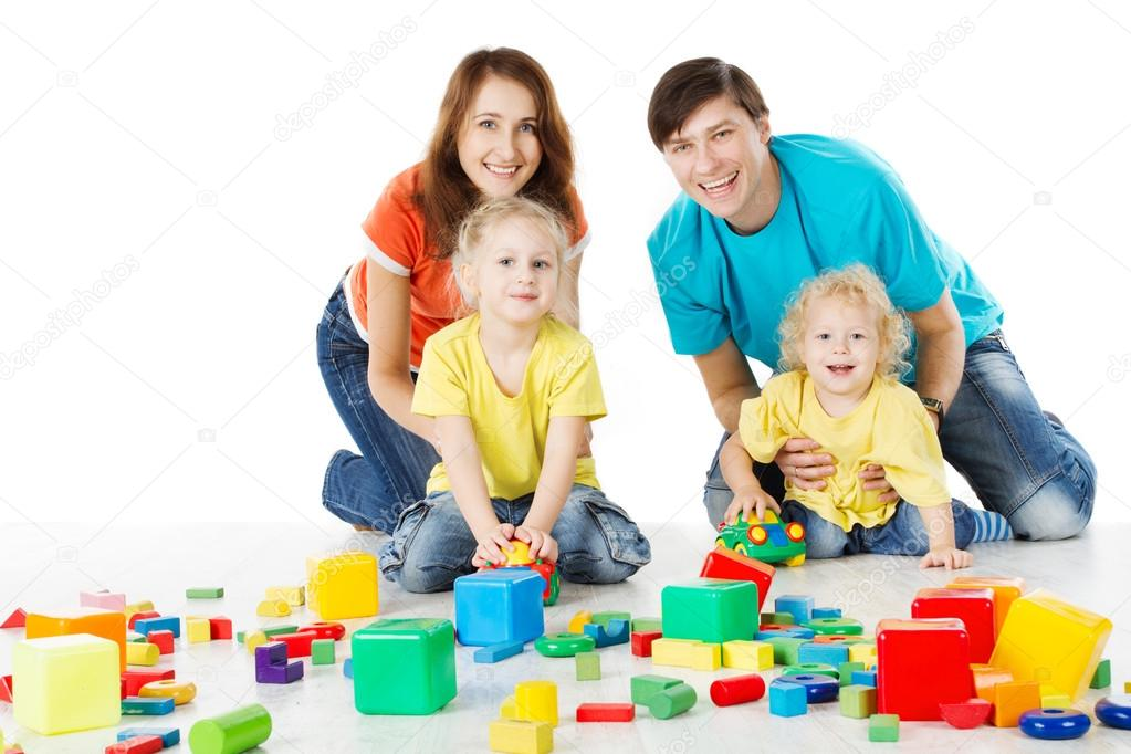 Toys For Family : Happy family parents with three kids playing toys blocks