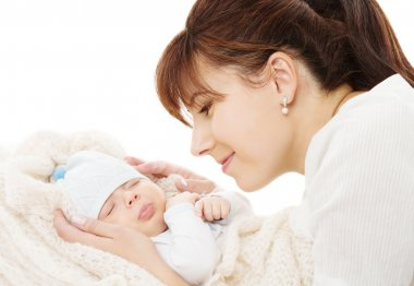 Mother holding newborn baby sleeping over white background