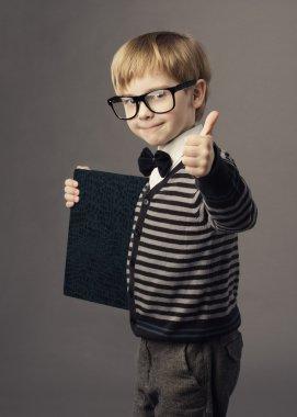 Boy little smart child in glasses showing blank card certificate, school education advertisemen