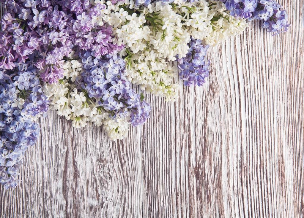 Lilac flowers on wood background, branch on wooden texture